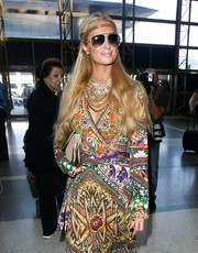 Paris Hilton accessorized with a pair of classic aviators--the only 'normal' thing about her bizarre airport look.
