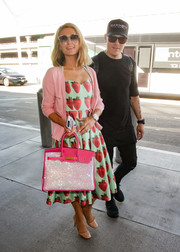 Paris Hilton amped up the sweetness with a pink cardigan.