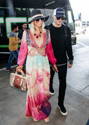 Paris Hilton paired her dress with an iridescent gold tote from her own label.