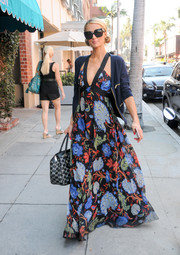 Paris Hilton went ultra girly in a floral maxi dress while out in Los Angeles.