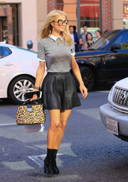 Paris Hilton styled her look with a pair of black patent and suede lace-up boots by Alaia.