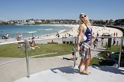 Paris Hilton kept it casual at Bondi Beach in Sydney, pairing classic flats with her swimwear and cover-up.