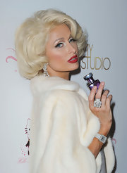 Paris showed off her stunnign panther cocktail ring while promoting her newest fragrance.