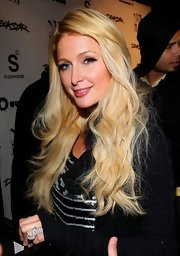 Paris Hilton attended the Steve Aoki 'Wonderland' release party wearing her hair in loose waves and her long bangs swept to the side.
