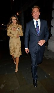 Elizabeth Hurley stepped out in a tan evening coat for her appearance at Patrick Cox's birthday party.