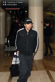 Patrick Dempsey traveled in comfort in a black and white striped track jacket.