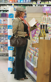 Raquel Welch was spotted out in a store carrying a brown leather tote.