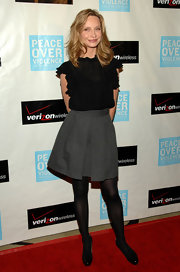 Calista wears a darling high waisted gray pleated skirt to the Peace Over Violence Awards.