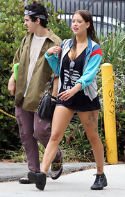 Peaches paired her short denim shorts with flat, leather, lace-up ankle boots.