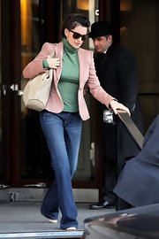 Penelope Cruz accessorized her casual street style with a neutral suede bag.