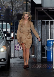 Penny Lancaster bundled up in a chic camel wrap coat.