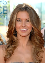 Audrina attending the People Choice nominations where she flaunted her center part long curls.