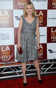 A red box clutch added some color to Michelle Pfeiffer's ensemble at the premiere of 'People Like Us.'