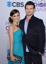 Rachael Leigh Cook accessorized her gown with a printed Ella McHugh clutch.