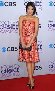 Shay Mitchell paired her dress with a black satin clutch.