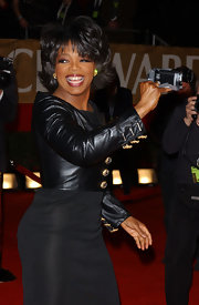 Oprah Winfrey layered a cropped black leather jacket with gold buttons over an LBD for a fierce finish at the People's Choice Awards.