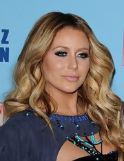 Aubrey Oday loves to bring the drama when she hits the red carpet. The singer walked the carpet at Perez Hilton's birthday with fluttering false lashes.