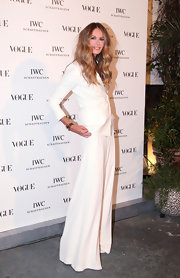Elle MacPherson is white hot in a sleek suit for the Vogue event in Italy.