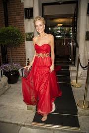 Petra Nemcova looked quite the princess in her red Marchesa strapless gown, featuring gold waist accents and a long train, as she headed to the Caudwell Children Butterfly Ball.