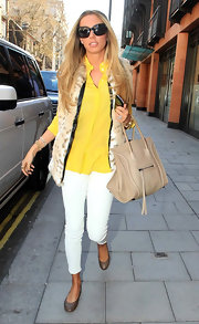 Petra Ecclestone stepped out for some shopping wearing a pair of classic flats with scalloped edges.