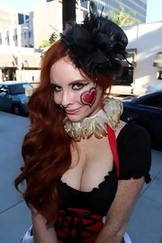 Phoebe Price looked, well, fascinating in a Queen of Hearts Halloween costume—made complete with a feathered fascinator.