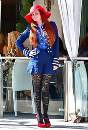 Phoebe Price opted for an out there nautical vibe in a navy blazer with striped cuffs.