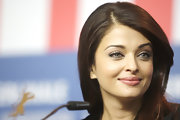Aishwarya loves her side part and her long healthy locks absolutely radiate in the light. Its no surprise she's a Loreal spokesmodel.