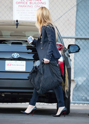 Piper Perabo left 'Kimmel' clutching an oversized black tote.