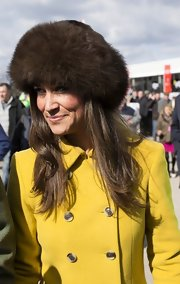 Pippa Middleton kept warm in this brown fur hat while at the Cheltenham Festival.