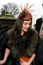 Pippa Middleton topped off her outfit with a feather-embellished fascinator.