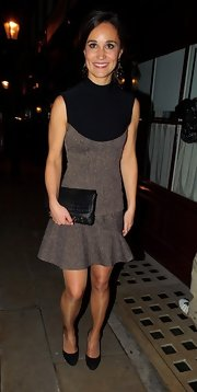 Pippa Middleton maintained a demure look for her night out in black pumps and a matching clutch.