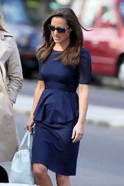 Pippa's style just keeps getting prettier! Check out this lovely navy Swiss dot peplum dress.