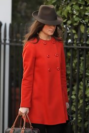 Pippa Middleton topped off her day look with a stylish brown fedora.