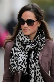 Pippa Middleton wore her long bangs clipped back while heading to work in London.