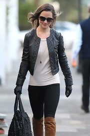 Pippa Middleton sharpened up her look with a pair of black leather gloves while walking to work.
