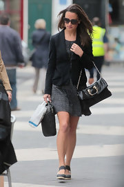 Pippa Middleton walked to work in style, with a black shoulder bag with gold hardware slung over her arm.