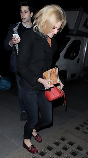 Pixie Lott traded in her signature colorful pieces for a more subtle look with this black pea coat.