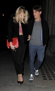 Pixie Lott enjoyed a date night wearing a black zip-up jacket over a gingham crop-top.