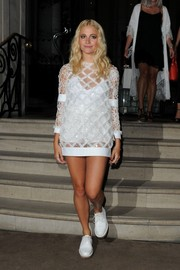 Pixie Lott opted for white leather lace-ups instead of heels to complete her attire.