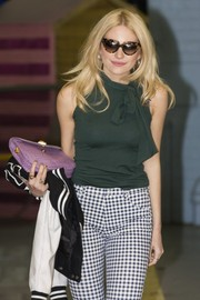 Pixie Lott stepped out of the ITV Studios wearing retro-chic tortoiseshell cateye sunnies by Prada.