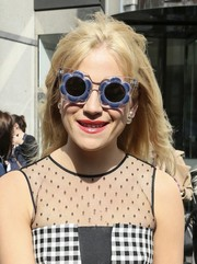 Pixie Lott got quirky with a pair of Linda Farrow flower sunnies as she left the ITV Studios.