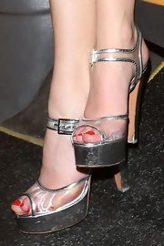Pixie Lott topped off her sleek modern look with these silver platform sandals.