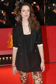 Rebecca wears a long black blazer over blingy sequined leggings at the 'Please Give' premiere.