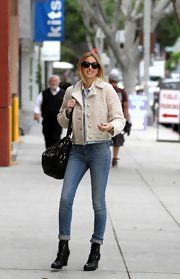 Whitney Port topped off her skinny jeans with black leather lace-up wedge boots.