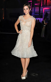 Emma Watson delighted at the 'Harry Potter' after-party in silver platform peep-toes.
