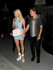 Pixie Lott towered in a pair of white ankle-cuff wedges while enjoying a night out.