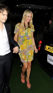 Denise van Outen donned a summer look wearing a floral short dress and a pair of strappy heels at the Pre-Wimbledon party.