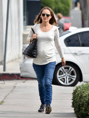 Natalie Portman was spotted out wearing a white maternity sweater with ruffled shoulders.