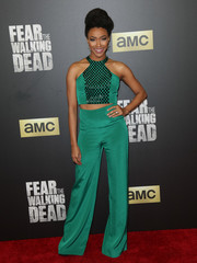 Sonequa Martin-Green flashed a bit of abs in an embellished emerald halter crop-top at the 'Fear the Walking Dead' season 2 premiere.