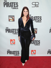 Kiana Madani paired her jumpsuit with an iridescent clutch.